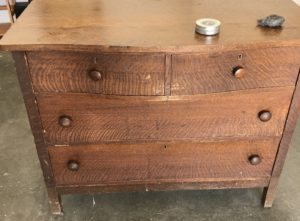 Example of a stained dresser before cleaning