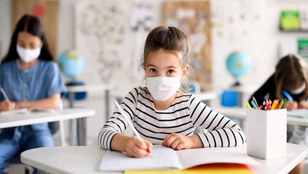 Children wearing masks inhale excessive levels of toxic carbon dioxide, study reports