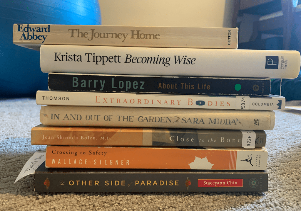 stack of books with text of poem