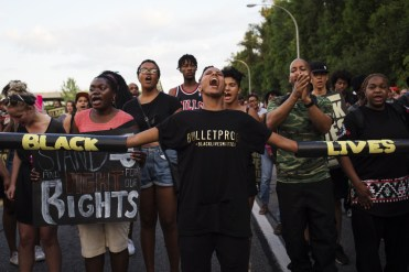 CI-LOKUCARBYPROTEST TORONTO, ON- JULY 27 - Janaya Khan (centre) screams during a Black Lives Matter protest that marched from Gilbert Avenue to Allen Road on Eglinton Avenue. The protest shut down the southbound Allen Road for around 30 minutes, causing traffic to reverse and exit through Lawrence Avenue. July 27, 2015 Melissa Renwick/Toronto Star