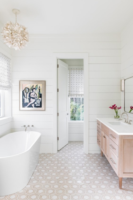 I love the gorgeous tile and shiplap walls in this beautiful bathroom design idea from Barrow Design Group via Home Bunch