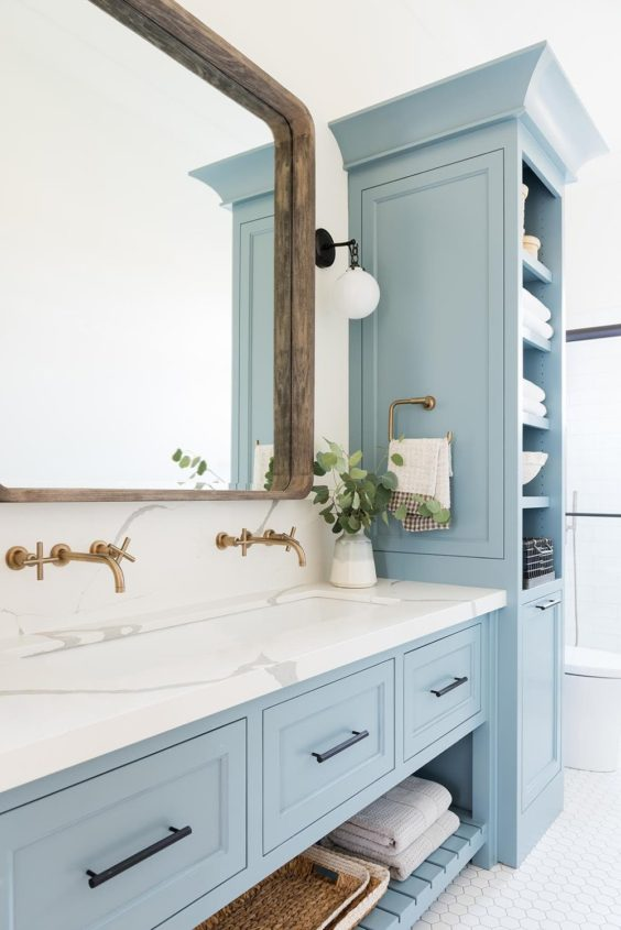 Beautiful bathroom design with blue vanity cabinet color and patterned black and white tile floor - California Traditional Project - Studiio McGee - bathroom ideas - bathroom decor - small bathroom ideas - bathroom remodel