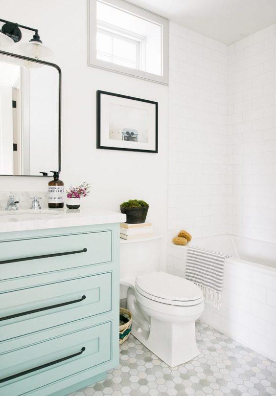 I love the soft blue green cabinets in this lovely small bathroom! bathroom ideas - bathroom decor - bathroom remodel - small bathrooms - powder bathroom - guest bathroom