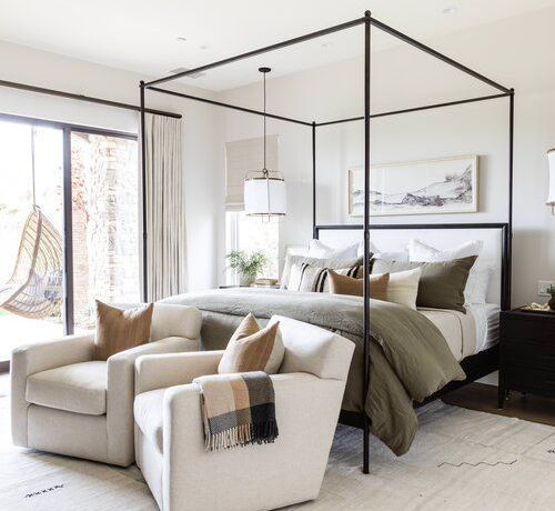 Beautiful bedroom with canopy bed and modern coastal accents - Pure Salt Interiors