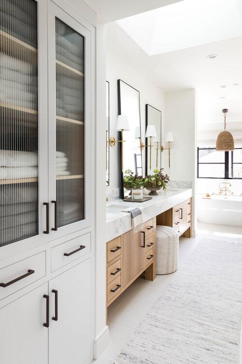 Beautiful modern master bathroom with light wood vanity - pure salt