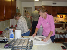 picture of Emily using pastry board to roll dough