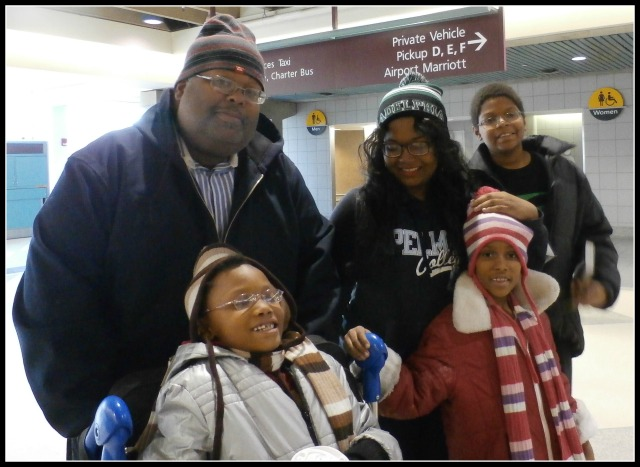 family at airport www.janeanesworld.com