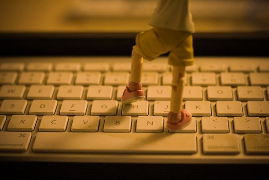 A small figurine stepping on a keyboard by KayVee.INC, via Flickr
