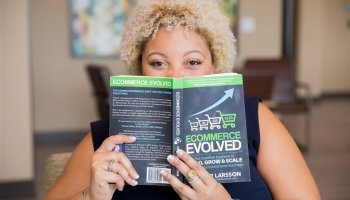 Janelle, creator of Hey J. Nicole, reading a recommended book for starting a business