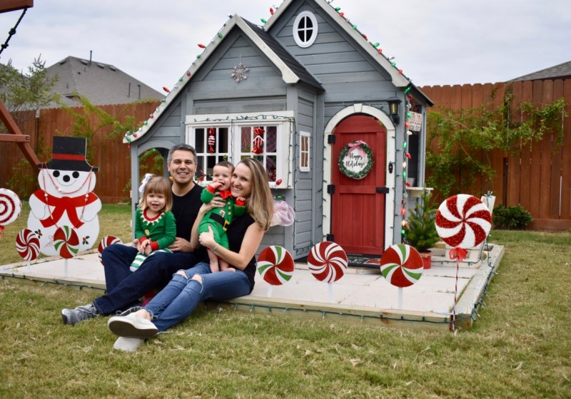 Family in front of holiday playhouse