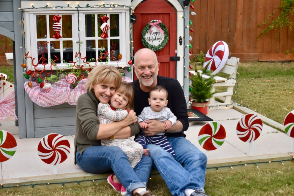 Grandparents in front of holiday playhouse