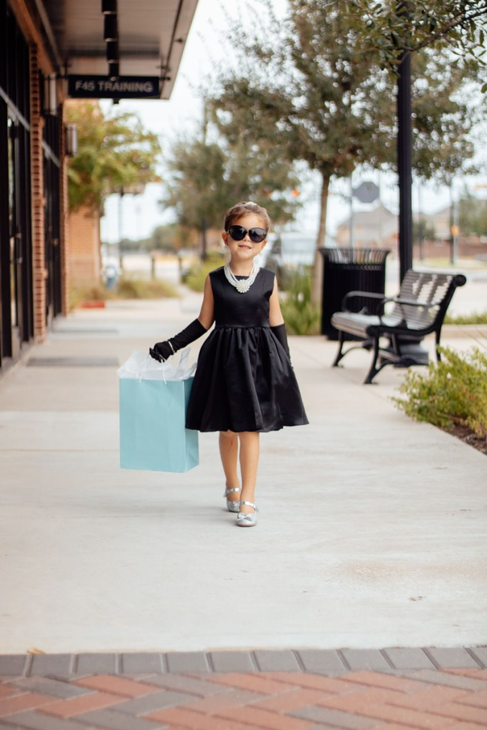 girl walking in audrey hepburn costume for breakfast at tiffany's inspired photoshoot