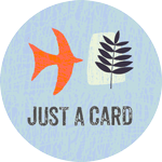 The logo of the Just a Card campaign - orange bird and black leaves on a blue circle