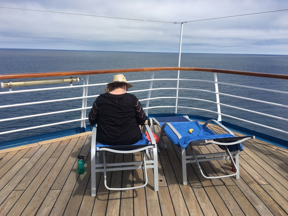 Cruise ship travel, deck, lounge chairs, ocean