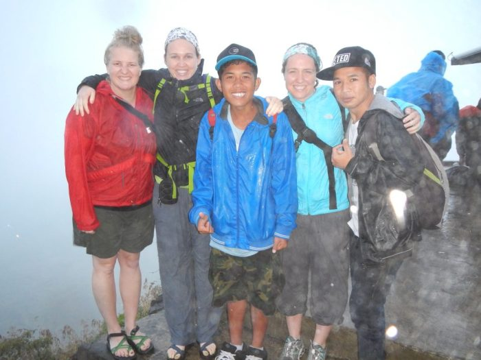 A soaking wet group after hiking in Bali