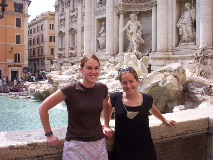 Standing in front of Trevi Fountain