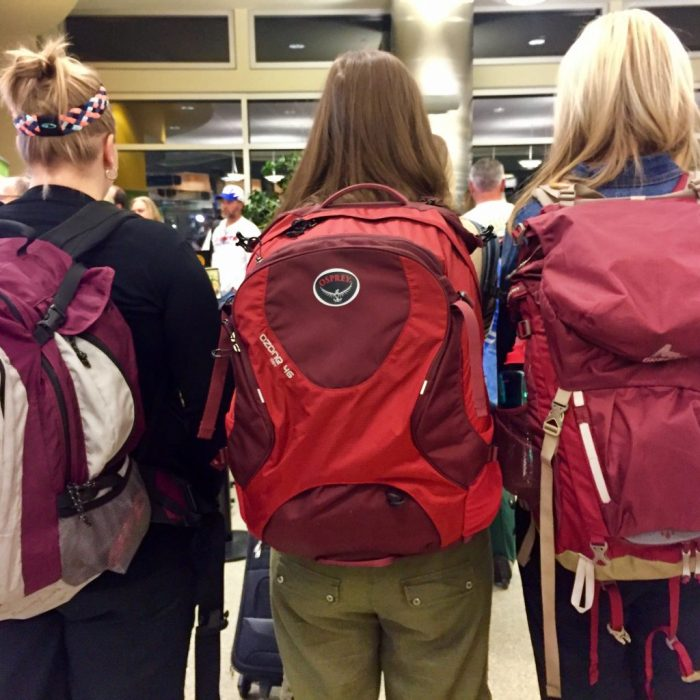 Three red carry-on backpacks women's packing list for Puerto Rico