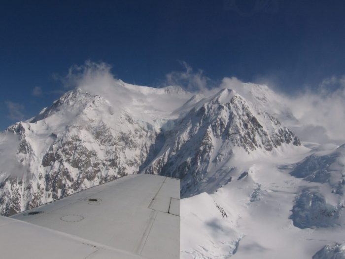 Flying in a plane around the Alaska Range