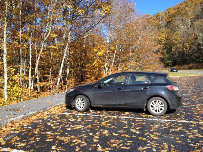 Mazda car rental in front of leaves turning colors