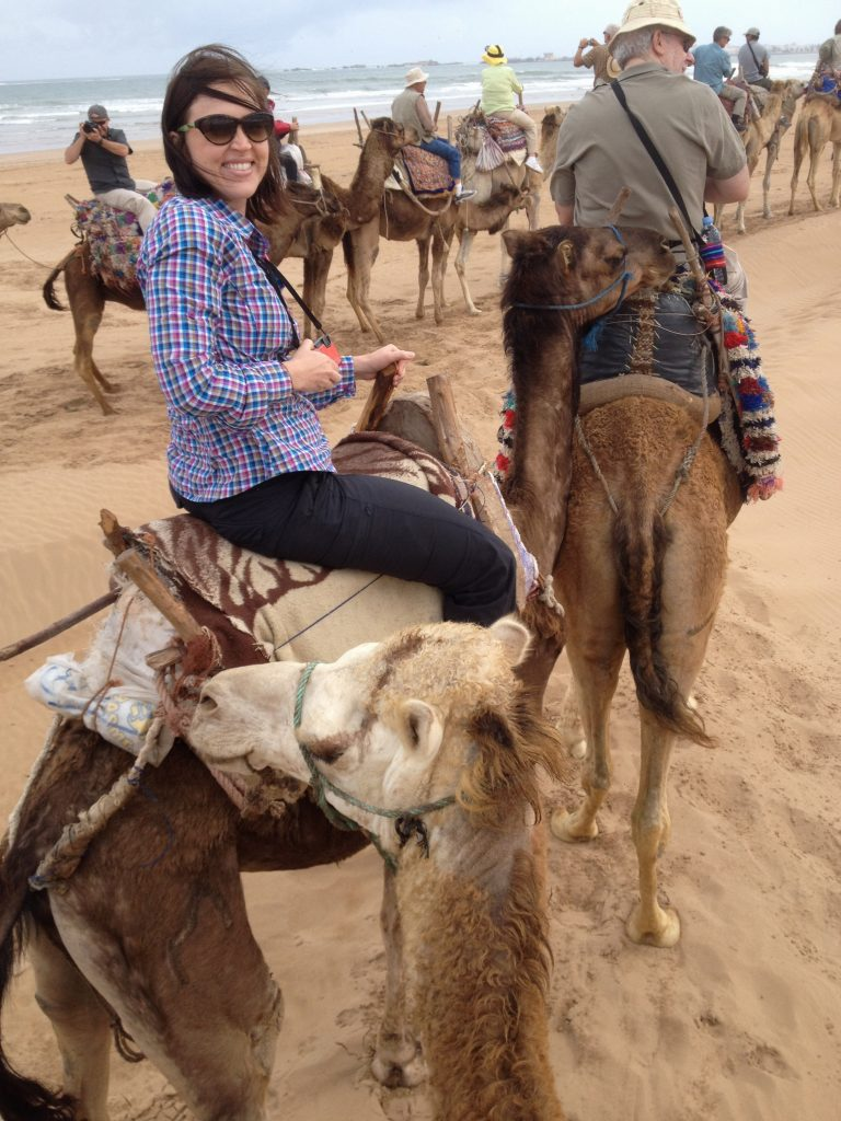Riding camels in Essouira, Morocco