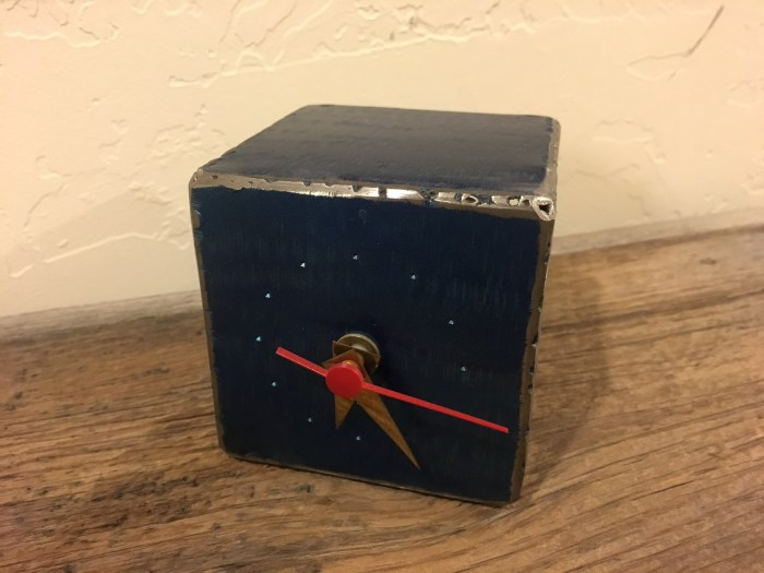 Metal clock from Tallinn, Estonia packing light tips and tricks for women travelers