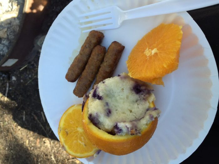 Blueberry Muffins baked over campfire in an orange