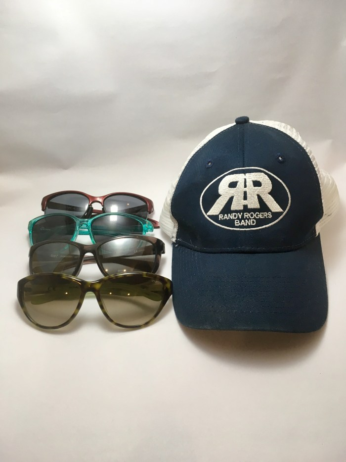 Sunglasses and a hat summer music festival preparation