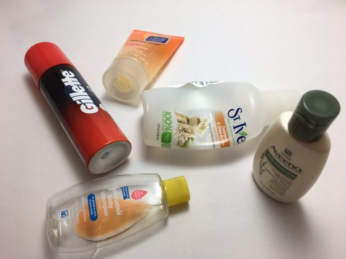 travel-size toiletries, small empty bottles, shampoo, shaving gel, lotion, body wash