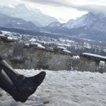tall black boots Salzburg Austria winter Alps