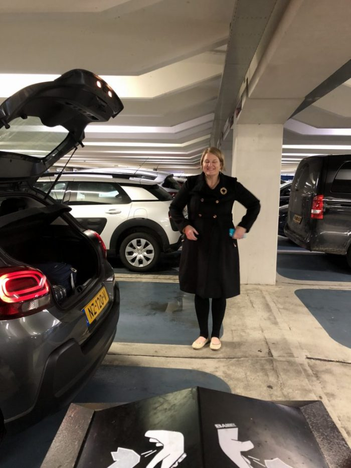 Amsterdam Netherlands airport rental car pick up Citron long black coat