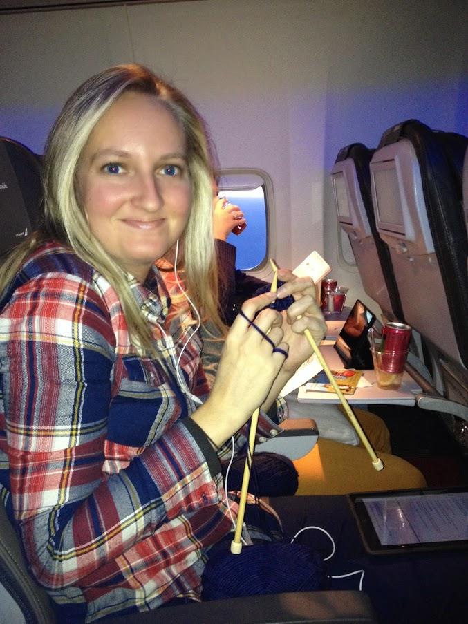 girl knitting on airplane