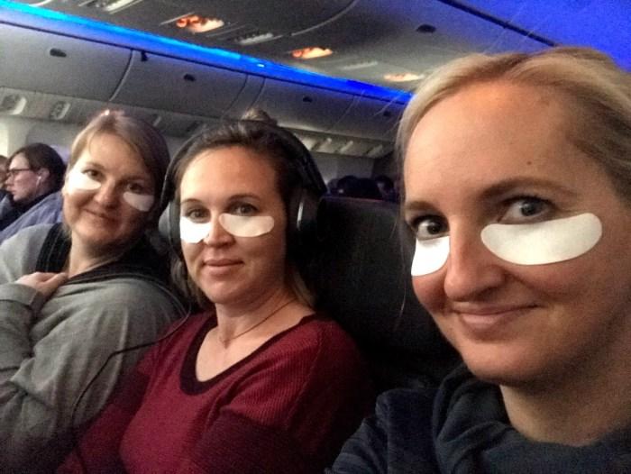 three friends, eye masks, airplane facials from a DIY airplane facial kit