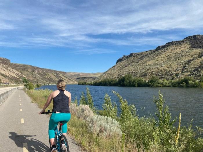 girl biking Boise Greenbelt Lucky Peak State Park