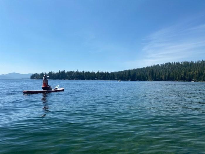 Girl on a paddleboard on Priest Lake, Idaho.