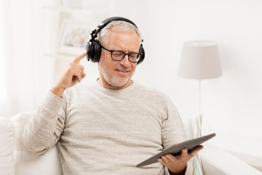 Senior Man on Headphones