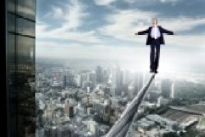 11321002-business-man-balancing-on-the-rope-high-in-the-sky