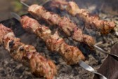 Shashlik cooking on an outdoor grill