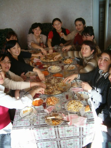 Here's a rather typical Dastarkhan (table top) set for Kuralai's 21st birthday. She's at the head of the table.