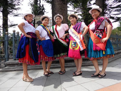 Young women posing in Parque Calderon – the large city park in the middle of downtown Cuenca.   These young women are dressed for a celebration; they usually wear western-style clothes during the normal work days.