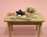 A doll's house scale tray cloth  and teacosy, available as kits from www.janetgranger.co.uk