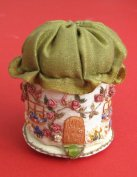 A pincushion 'Rose Cottage', by Carolyn Pearce