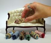 Doll's house scale bolster cushions, stitched on 32 count silk gauze. Kits available from www.janetgranger.co.uk