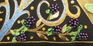 Close-up of stumpwork blackberries on the 'Illuminated Floral' panel, by Alison Cole