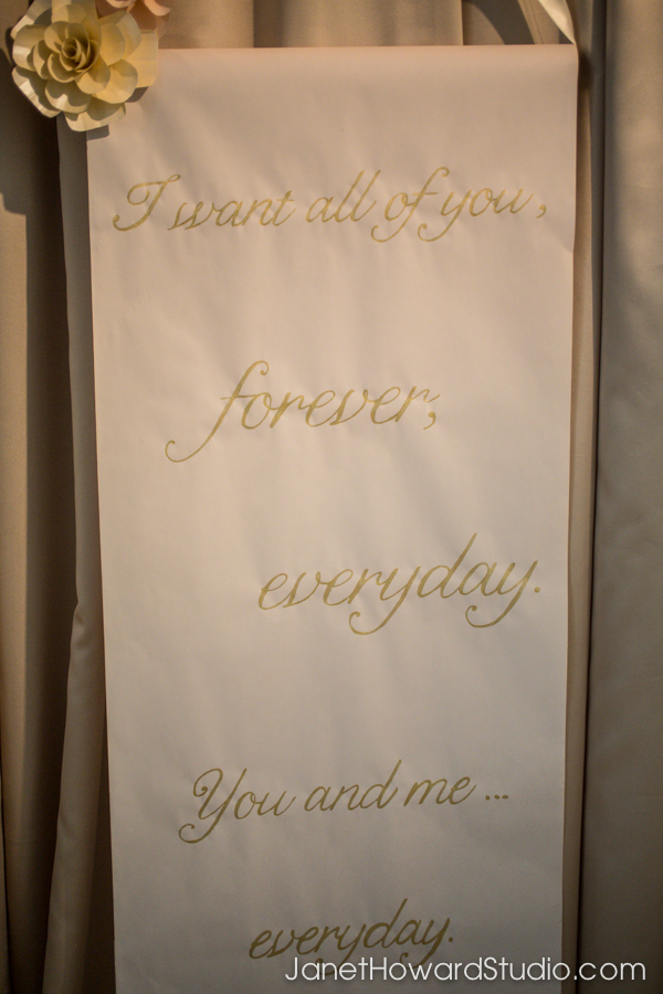 Gold text scroll for ceremony backdrop