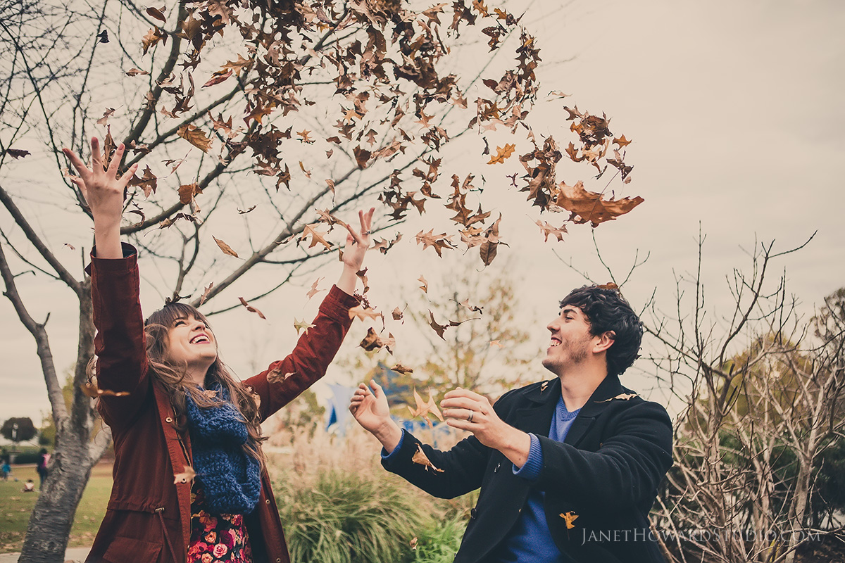 Leaf throwing fall engagement
