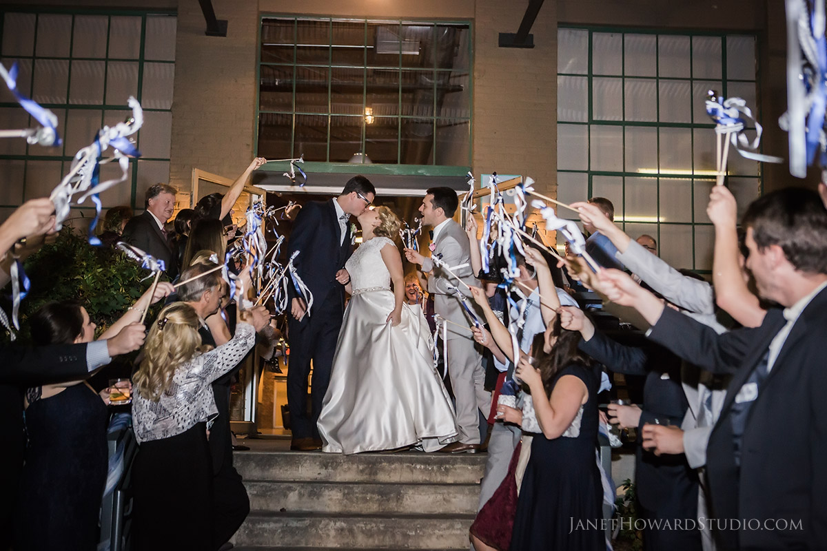 Bride and Groom exit at The Foundry at Puritan Mill