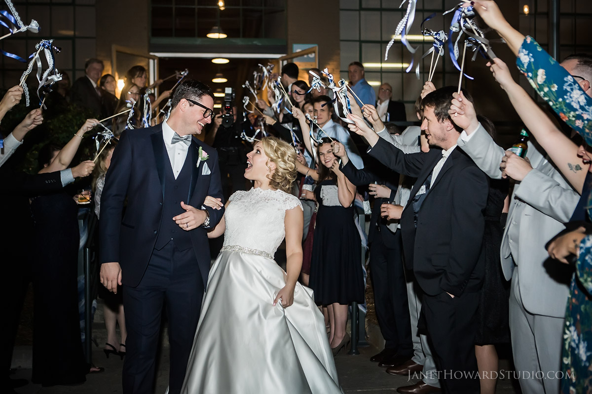Bride and Groom exit with ribbon wands at The Foundry at Puritan Mill