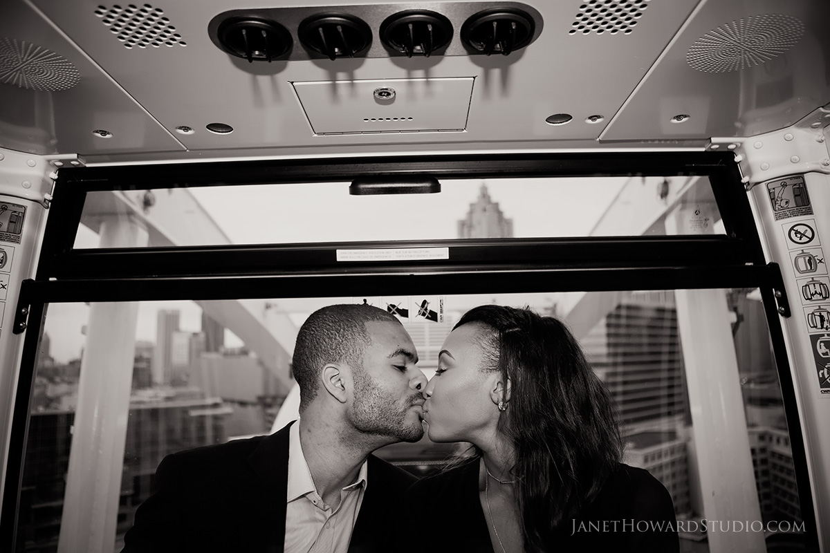 Atlanta engagement photos at sky view ferris wheelAtlanta engagement photos at sky view ferris wheel