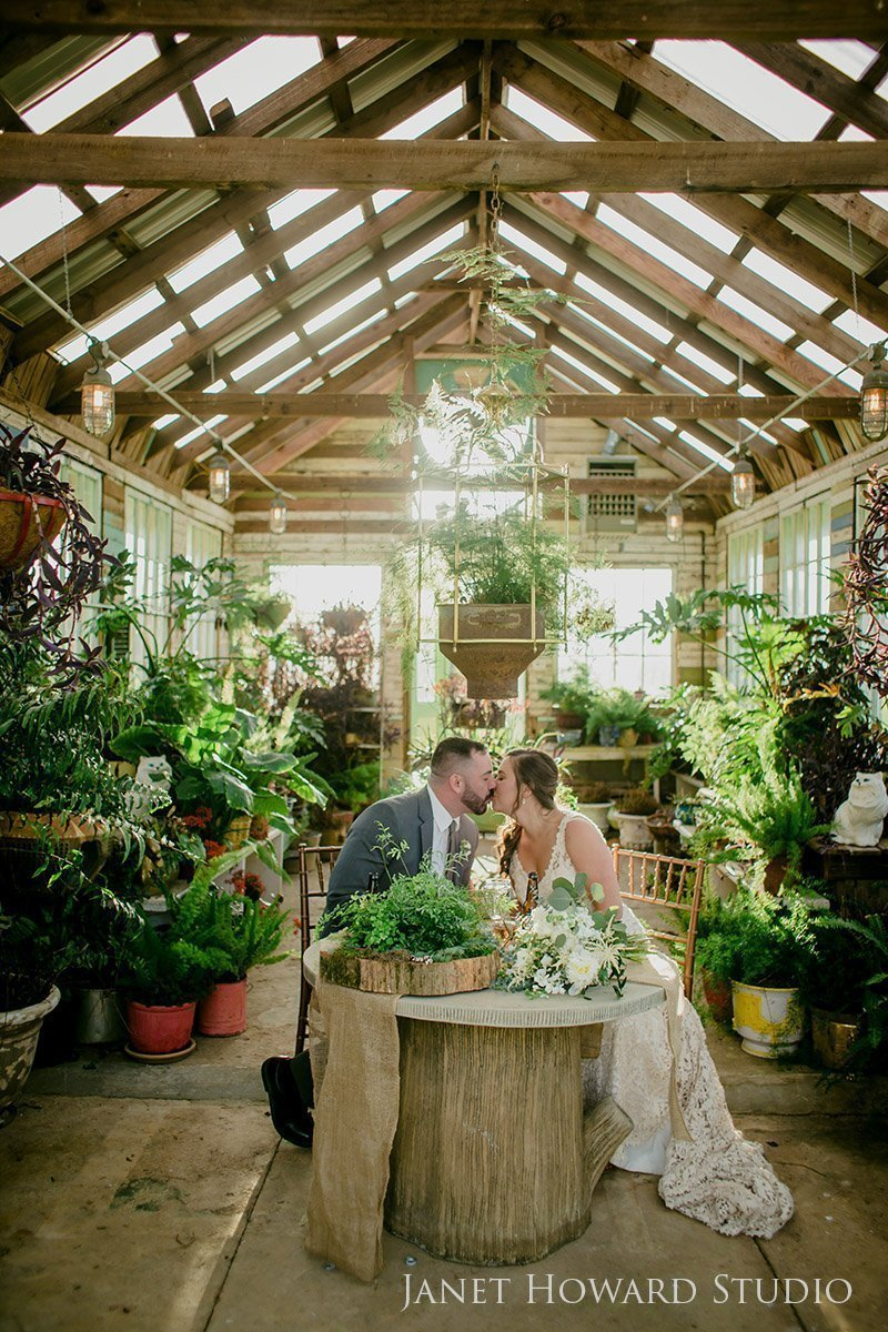 Bride and Groom in greenhouse at West Milford Farm