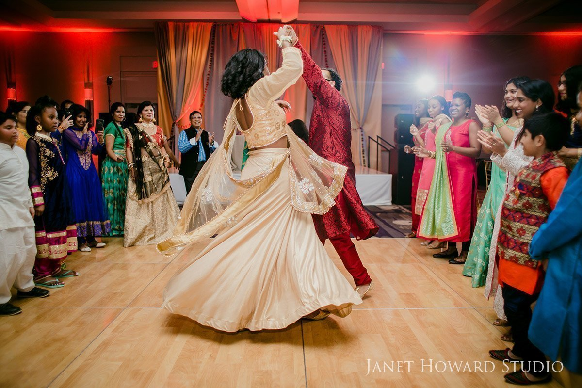 bride and groom dancing at Sangeet